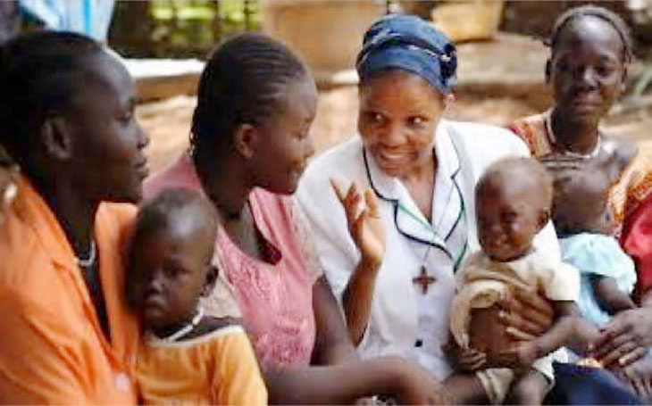 African nurse helping mom and kids