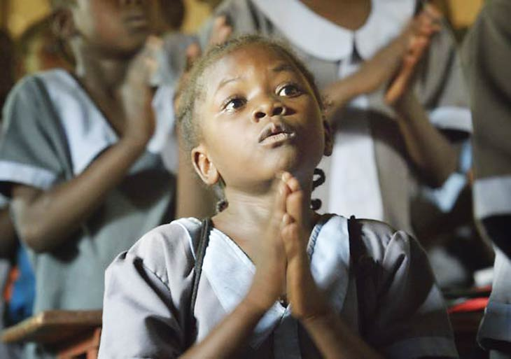 South Sudan girl praying for peace