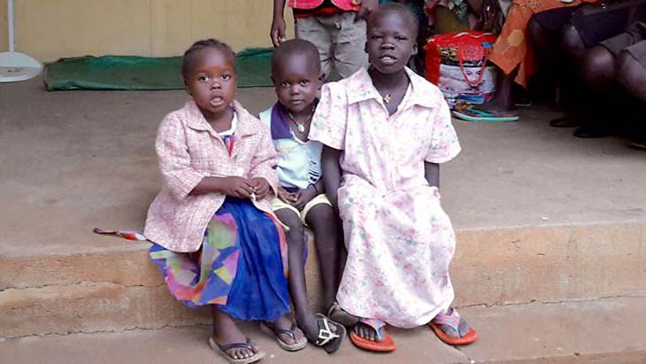 South Sudanese sitting on porch step
