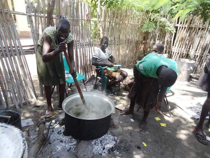 South Sudan woman stirring pot